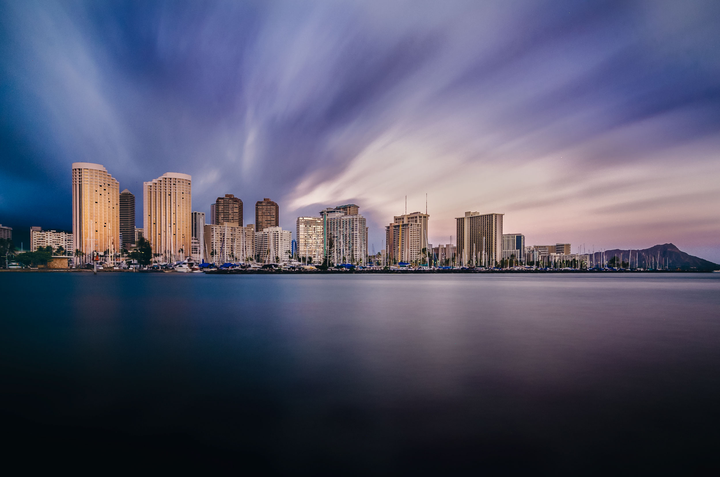 must see photo locations when visiting oahu hawaii long exposure sunset over honolulu hawaii