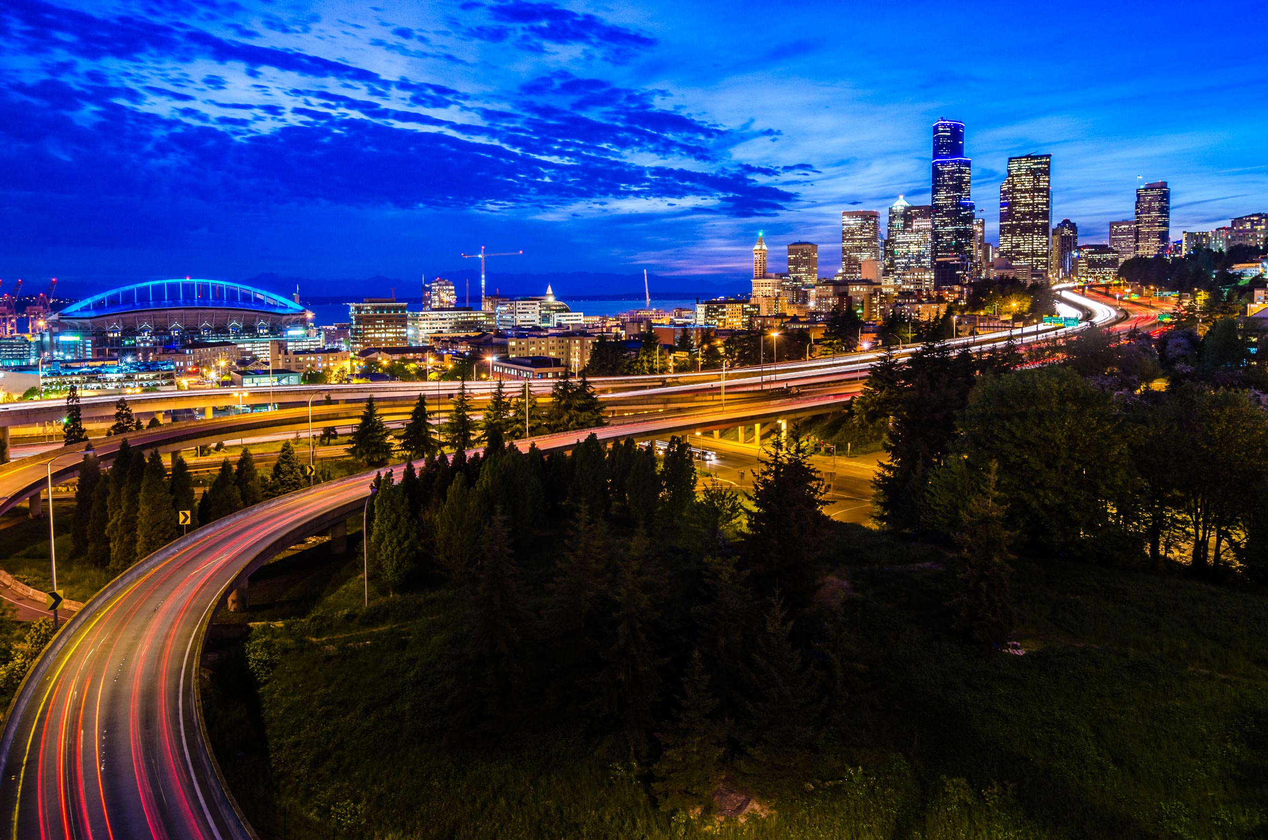 seattle skyline with light trails on the curved interstate