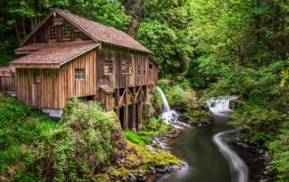 landscape photo of cedar creek grist mill with water running